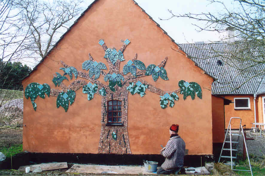 Tree mosaic on the side of Elatan's brother's house.